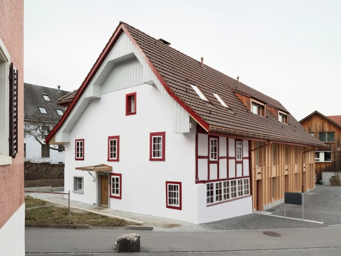 A Barn Replacement + Farmhouse Restoration by Singer Baenziger Architekten